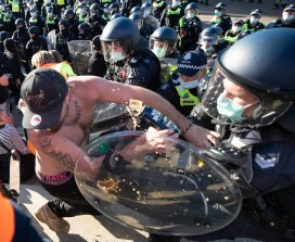 Police clash with protestors at the Shrine on Wednesday.