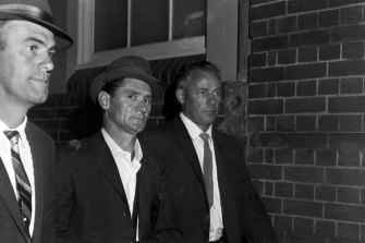 Melbourne prison escapee Ronald Ryan being taken to police headquarters in Sydney after his recapture on January 5, 1966.