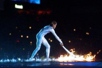 Cathy Freeman lights the flame.