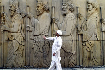 A Zoroastrian priest outside a fire temple in Mumbai, India.