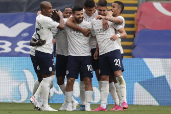 Sergio Ageuro is congratulated by his City teammates after scoring.