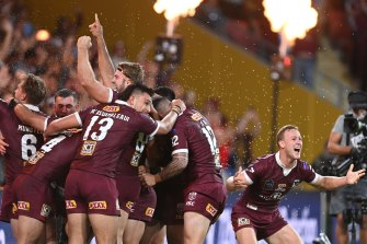 The Maroons celebrate after the siren.