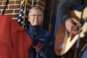 "Mitch McConnell listens to singer Jimmy Rose perform ""Coal Keeps the Lights On"" in his coal-mining home state of Kentucky in 2014."