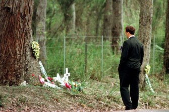 Walter Mikac in front of the tree where his daughter was killed at the one-year memorial service of the Port Arthur massacre.