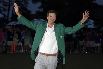 Adam Scott shows off his green jacket after winning the Masters golf tournament in 2013.