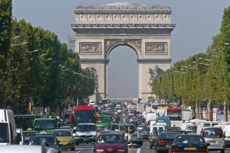 The roundabout of the Arc de Triomphe in Paris, approached from the Avenue de Champs-Elysees.