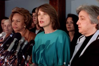 National Organization for Women President Patricia Ireland, center, flanked by Dr. Jane Smith, president of the National Council of Negro Women, left, and Eleanor Smeal, president of the Feminists Majority, meet reporters to demand the Republican Congress to drop efforts to impeach President Clinton.