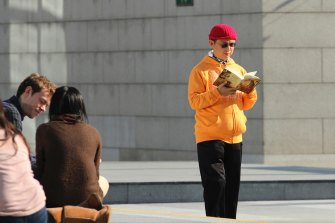 Xiao Jianhua, a Chinese-born Canadian billionaire, reads a book outside the International Finance Centre in Hong Kong.