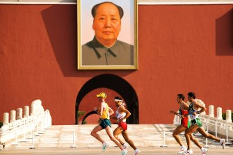 Australia's Lee Troop leads his group past the Forbidden City and Mao's portrait at the 11-km mark of the Beijing Summer Olympics 2008 marathon. Troop finished 60th.
