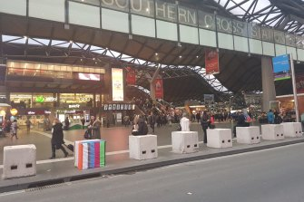 At Southern Cross Station, a temporary safety bollard is treated to some guerilla art.