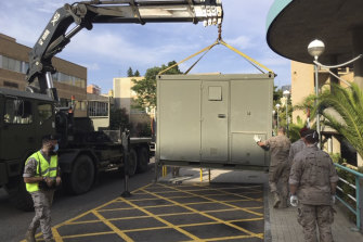 Soldiers set up a temporary ward in the car park of a hospital in Zaragoza.