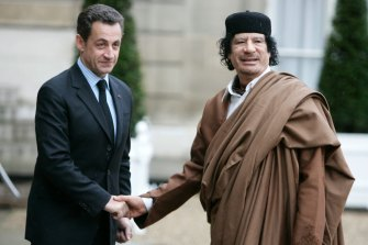 In this December 2007 file photo, French President Nicolas Sarkozy, left, greets Libyan leader Col. Moammar Gadhafi upon his arrival at the Elysee Palace, in Paris.