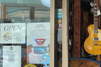 """Several shops in Mullumbimby have """"No Mask, We Don't Ask"""" signs in their windows."""