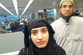 Tashfeen Malik and Syed Farook, as they passed through O'Hare International Airport in Chicago, in 2014.