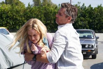 Terra Newell (Julia Garner) attempts to fight off John Meehan (Eric Bana) in season one of Dirty John.