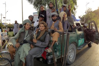 Taliban fighters patrol inside the city of Kandahar province in the south-west of Afghanistan.