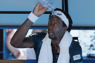 France's Gael Monfils douses himself with water due to the searing heat on court during the Australian Open in Melbourne in 2018.
