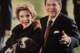 First lady Nancy Reagan holds the Reagans' pet Rex, a King Charles spaniel, on the White House South lawn.