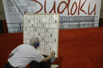 A competitor works on his Sudoku puzzle during a national championship in Philadelphia, US.