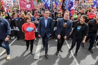 Luke Hilakari (second from right, front row) alongside Premier Daniel Andrews at a protest.