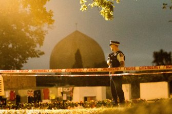 A policeman stands guard at al-Noor Mosque in Christchurch a week after the massacre.