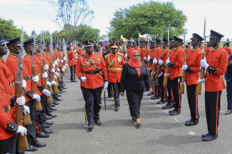 Samia Suluhu Hassan inspects the guard of honour after being sworn in.