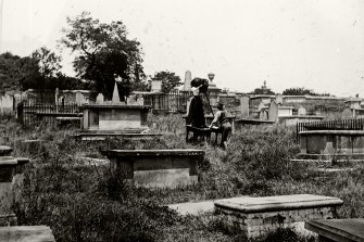 The Fosters take photographs at the former Devonshire Street Cemetery.