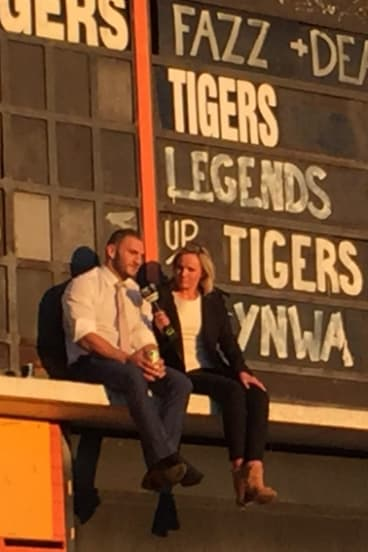 Farah took a moment to himself with a beer up on the Leichardt Oval scoreboard to mark his Tigers exit two years ago.