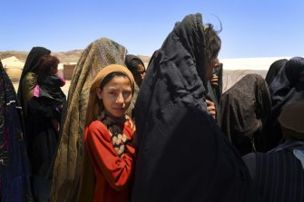 Women and children wait outside an out patient department facility in Regreshan IDP camp in Herat Province. Jonathan Lee's book makes the point that the Afghan people have played little part in the disorder that has affected the country in the past four decades.