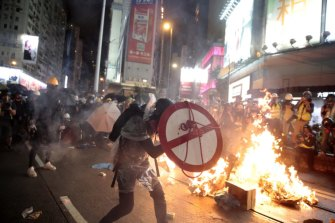 A protestor uses a shield to cover himself as he faces police in Hong Kong, Saturday, August 31, 2019.