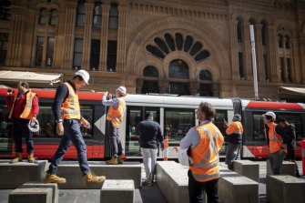 The tram passes the Queen Victoria Building on George Street on Wednesday.