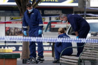 Police inspect the area where Fiona Warzywoda was murdered in the Sunshine shopping precinct.