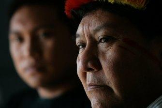 Kopenawa Yanomami, right, with his son Dario.