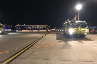 An emergency vehicle on the tarmac at Melbourne Airport after Manodh Marks threatened those on Malaysia Airlines Flight MH128.