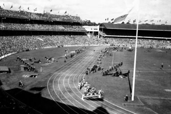 A crowd of nearly 90,000 watches the Olympic 3,000 metres steeplechase at the M.C.G. on 27 November 1956.