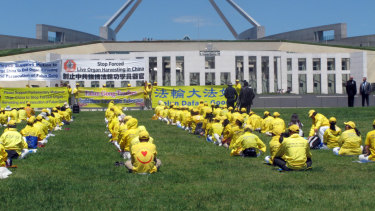 Falun Gong practitioners demonstrate outside the Australian Parliament House in Canberra in 2016.