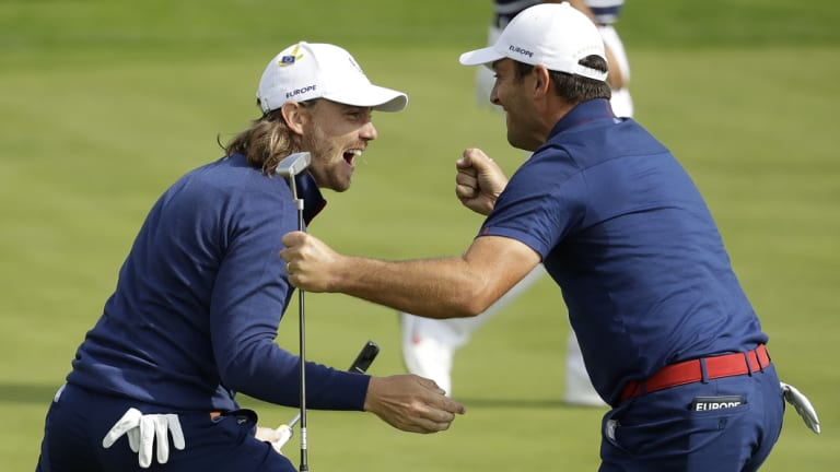 Europe's Francesco Molinari, right, and Tommy Fleetwood win a hole in their fourball match.