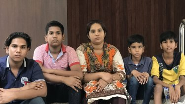 Pakistani Christian refugee Soniazahid Younis with her four sons, Shahzaib, 16, Shahwaiz, 14, Sharaiz, 10 and Zohaib, 8, at Xavier Hall in Bangkok. The family fled persecution in Pakistan and live in a legal limbo.