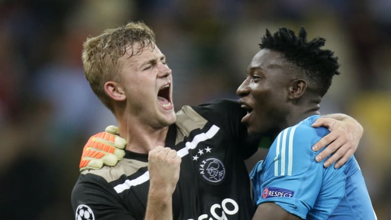 Sweet victory: Ajax's Andre Onana, right, and Maximilian Wober celebrate at the final whistle.