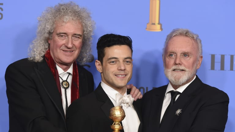 Brian May, left, and Roger Taylor, right, of Queen, and Rami Malek pose with the Golden Globe for Best Motion Picture, Drama for Bohemian Rhapsody.