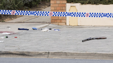 A shotgun lying on a Queanbeyan street where an armed man was shot by police on Saturday morning.