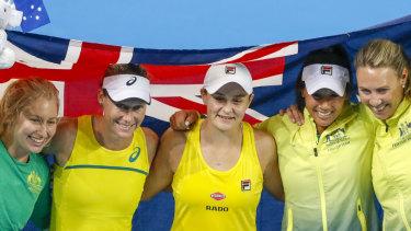 Daria Gavrilova, Stosur, Barty, Priscilla Hon and coach Alicia Molik celebrate Australia's win.