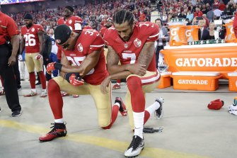 San Francisco 49ers safety Eric Reid (35) and quarterback Colin Kaepernick (7) kneel during the national anthem in 2016.