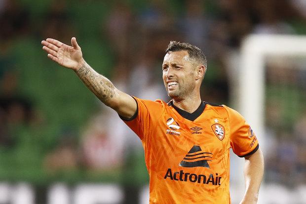 Signs of frustration: Brisbane striker Scott McDonald urges his side on.