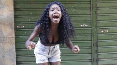 A resident protests a police operation targeting drug traffickers in the Jacarezinho favela of Rio de Janeiro.