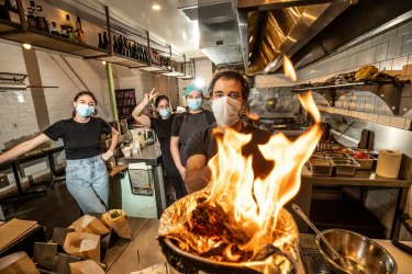 Afik Gal & the crew at Miznon in Hardware Lane are ecstatic abouth opening up again. Seen here burning sage to cleanse the restaurant before reopening. Photo by Jason South. 21st October 2021