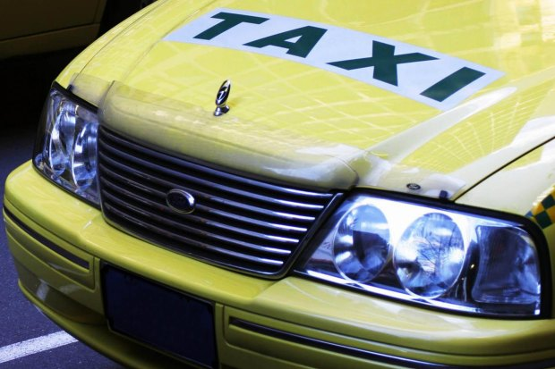 A taxi driver was assaulted by a hammer-wielding passenger on Sunday afternoon