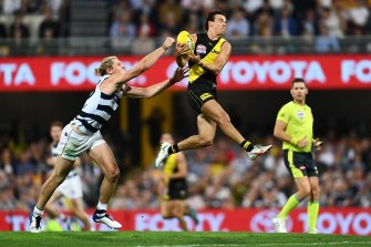 BRISBANE, AUSTRALIA - OCTOBER 24: Daniel Rioli of the Tigers marks during the 2020 AFL Grand Final match between the Richmond Tigers and the Geelong Cats at The Gabba on October 24, 2020 in Brisbane, Australia. (Photo by Quinn Rooney/Getty Images)