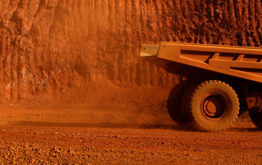 Iron ore storms past $US100 as China soothes Evergrande concerns