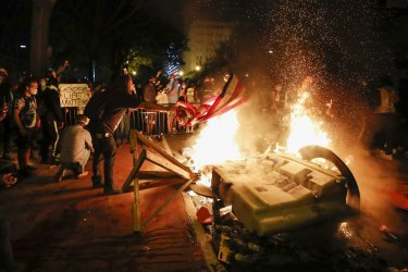 Demonstrators start a fire as they protest the death of George Floyd near the White House in Washington. Floyd died after being restrained by Minneapolis police officers.